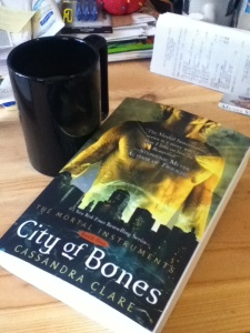 The Mortal Instruments Book One, plus the coffee needed when you stay up too late reading this series